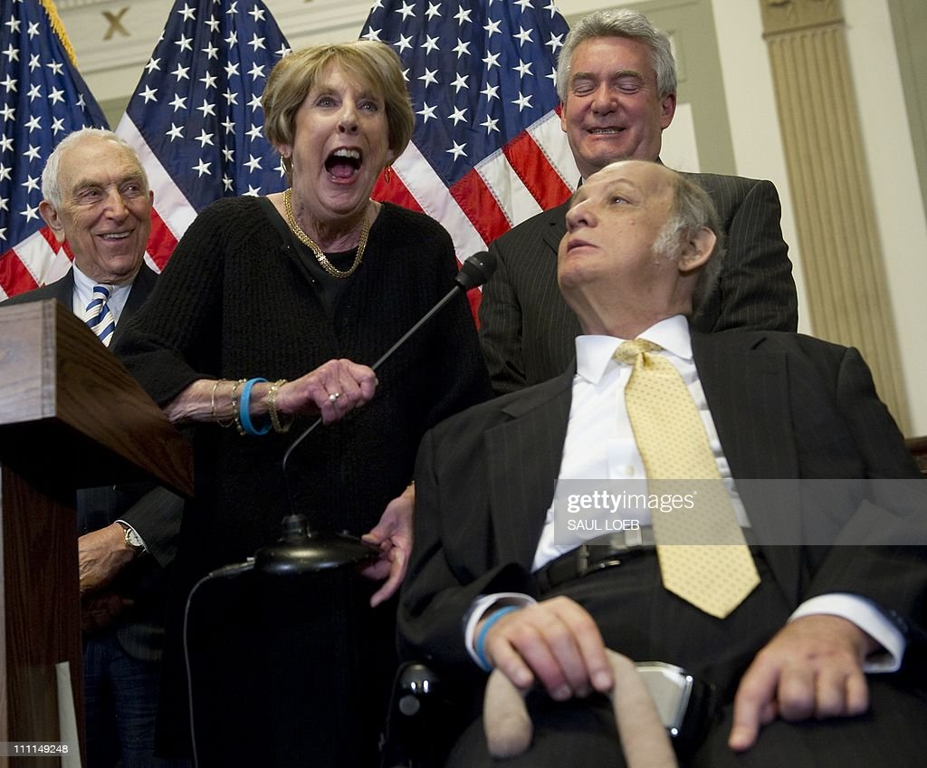 Former White House Press Secretary Jim Brady (2nd R) makes his wife, Sarah (2nd L), laugh alongside Brady Campaign President Paul Helmke (2nd R), and US Democrat Senator <a gi-track='captionPersonalityLinkClicked' href=/galleries/search?phrase=Frank+Lautenberg&family=editorial&specificpeople=240397 ng-click='$event.stopPropagation()'>Frank Lautenberg</a> (L) of New Jersey, about new legislation curbing gun violence during a press conference on Capitol Hill in Washington, DC, March 30, 2011. Brady was shot by John Hinkley, Jr, during his attempt to assassinate former US President Ronald Reagan on March 30, 1981. AFP PHOTO / Saul LOEB