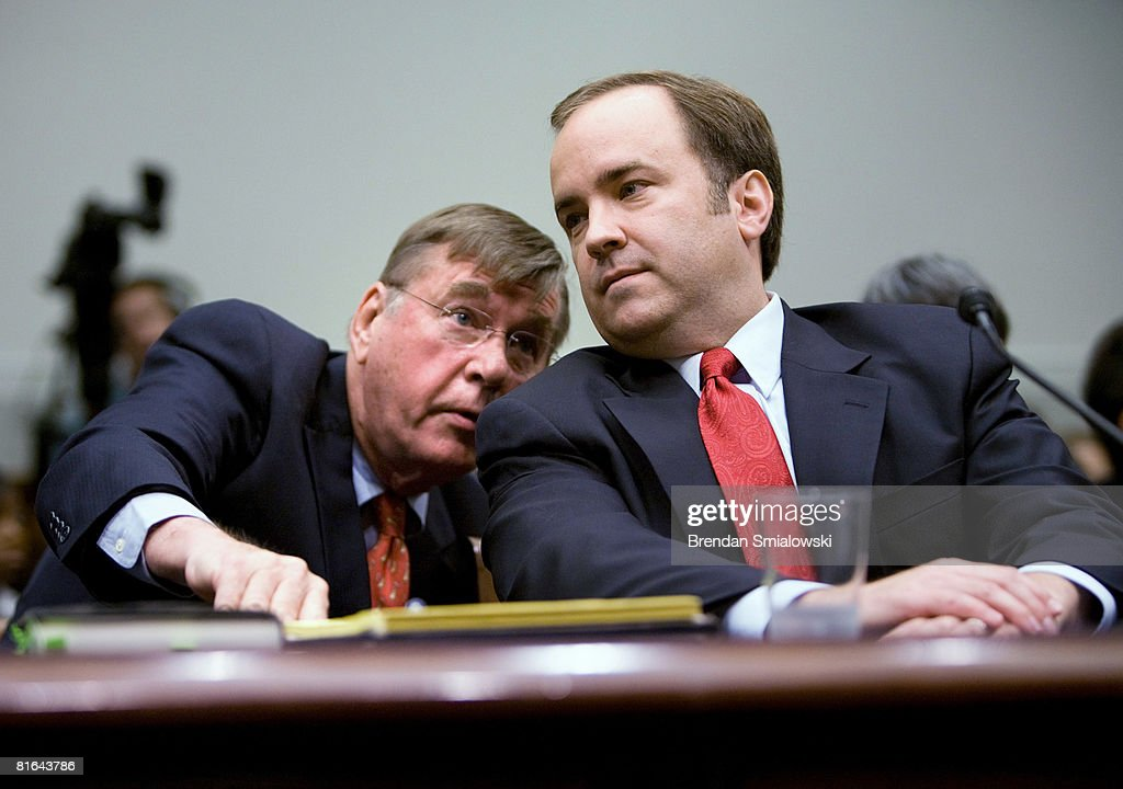 Former White House Press Secretary Scott McClellan (R) listens to his lawyer Michael Tigar during a hearing of the House Judiciary Committee on Capitol Hill June 20, 2008 in Washington, DC. McClellan, a former White House press secretary for U.S. President George W. Bush, appeared before the committee to testify about the leak of CIA agent Valerie Plame's identity.