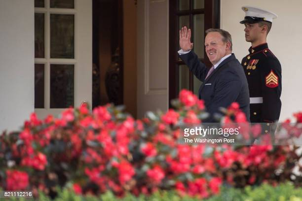 Former White House press secretary Sean Spicer walks into the West Wing after abruptly resigning his position at the White House in Washington DC on...