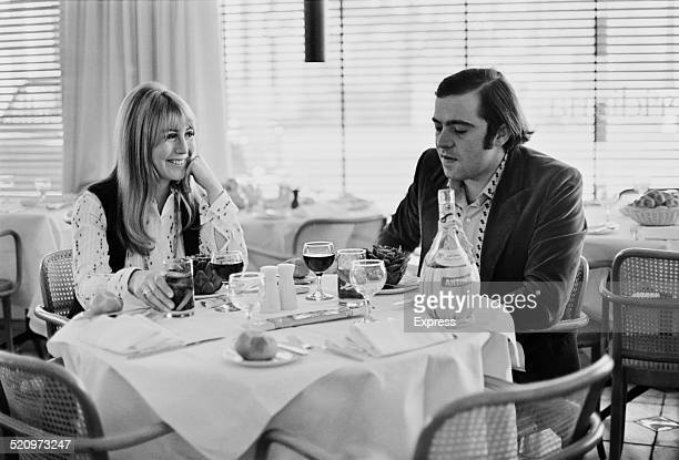 Former wife of musician John Lennon Cynthia Lennon and Italian hotelier Roberto Bassanini dining together in a restaurant 1969