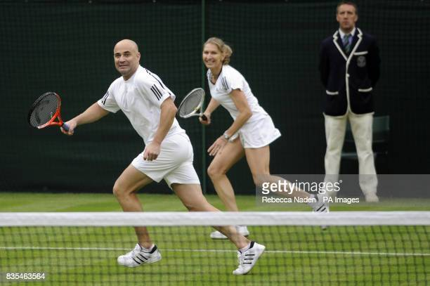 Former Wimbledon champion Steffi Graf in action with her husband and partner Andre Agassi during an exhibition match against Great Britain's Tim...