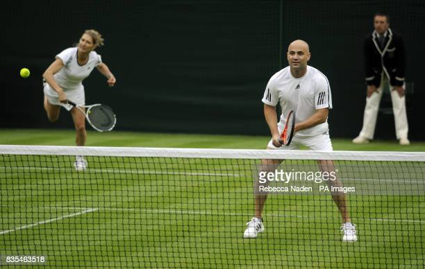 Former Wimbledon champion Steffi Graf in action with her partner and husband Andre Agassi against Great Britain's Tim Henman and Kim Clijsters on...