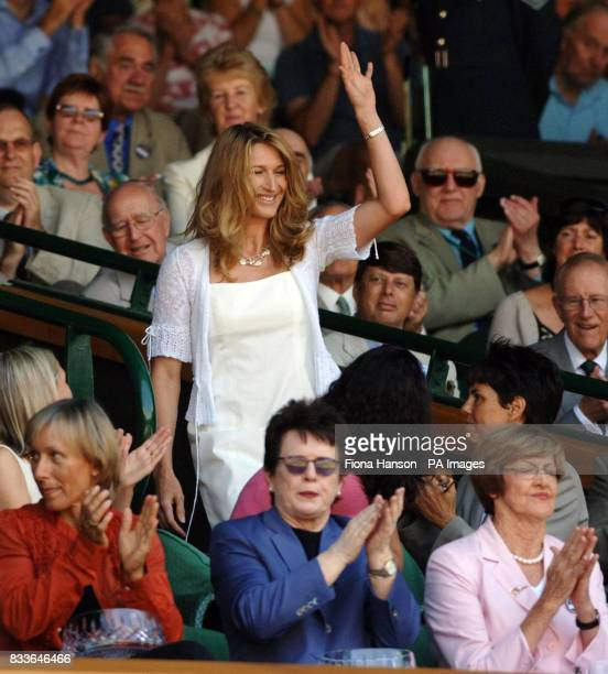 Former Wimbledon champion Steffi Graf is applauded by Martina Navratilova and Billie Jean King in the Royal Box on Centre Court during the third...