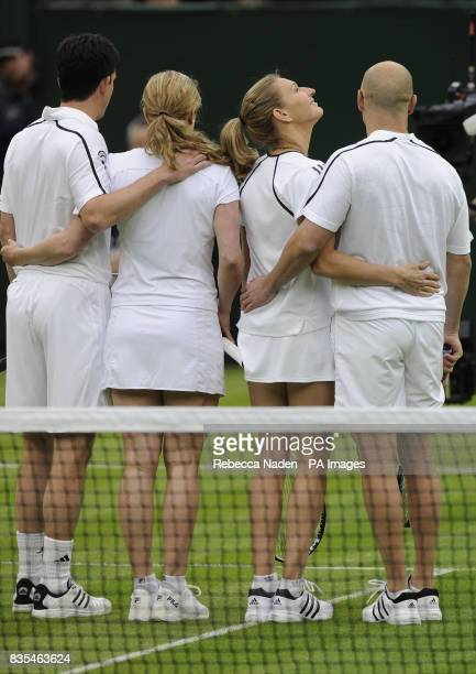 Former Wimbledon champion Steffi Graf looks up at the roof with her husband Andre Agassi as they stand with Great Britain's Tim Henman and Kim...