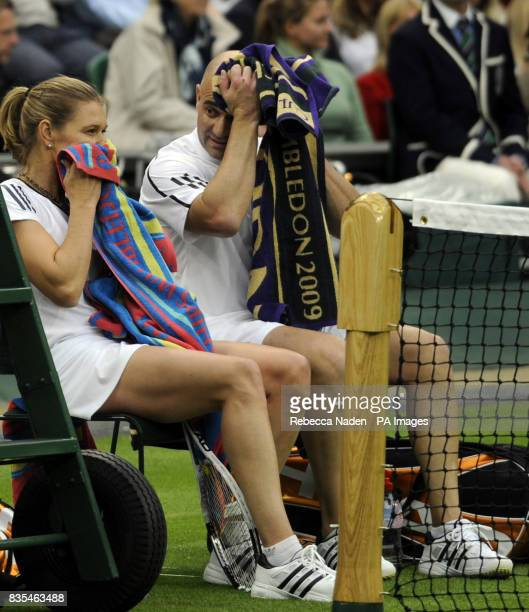 Former Wimbledon champion Steffi Graf take a break with her partner and husband Andre Agassi against Great Britain's Tim Henman and Kim Clijsters on...