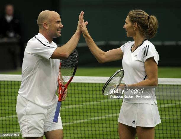 Former Wimbledon champion Steffi Graf with her husband and partner Andre Agassi at the end of an exhibition match against Great Britain's Tim Henman...