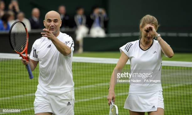 Former Wimbledon champion Steffi Graf with her partner and husband Andre Agassi against Great Britain's Tim Henman and Kim Clijsters on centre court...