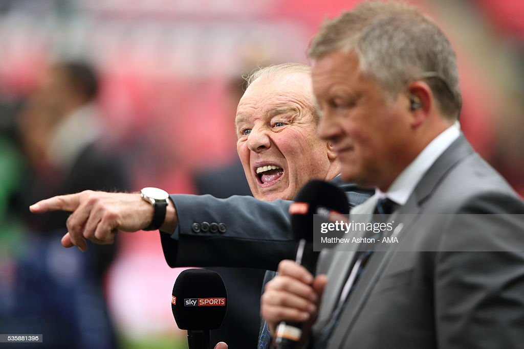Former Wimbledon manager Dave Bassett, working for television broadcaster Sky Sports, celebrates the promotion of AFC Wimbledon in the Sky Bet League Two Play Off Final between Plymouth Argyle and AFC Wimbledon at Wembley Stadium on May 30, 2016 in London, England.