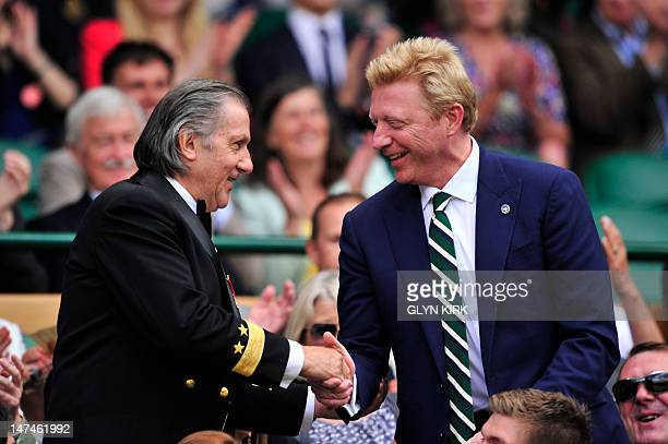 Former Wimbledon men's singles champion Boris Becker greets former Romanian Wimbledon men's singles finalist Ilie Nastase in the Royal Box before...