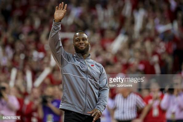 Former Wisconsin Badger running back and current New England Patriots running back James White talks gets introduce to the crowd durning a timeout...