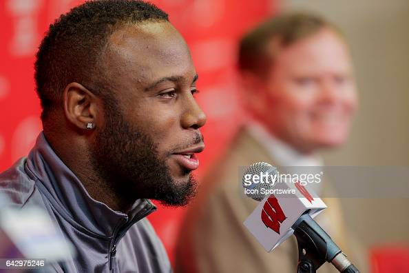 Former Wisconsin Badger running back and current New England Patriots running back James White talks with the media prior to an college basketball...