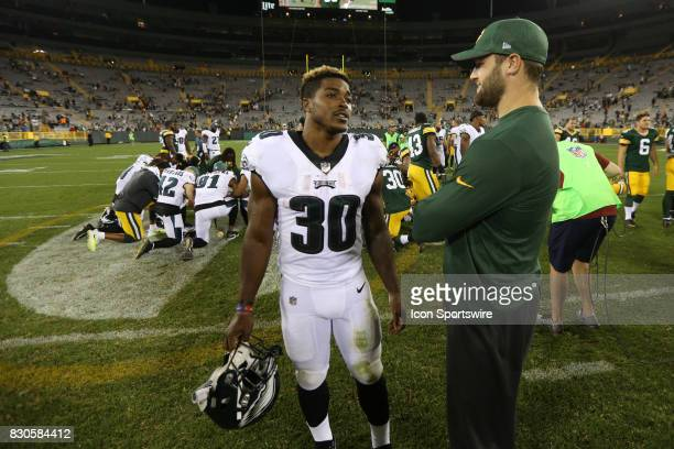 Former Wisconsin Badger teammates Philadelphia Eagles running back Corey Clement and Green Bay Packers outside linebacker Vince Biegel talk after a...