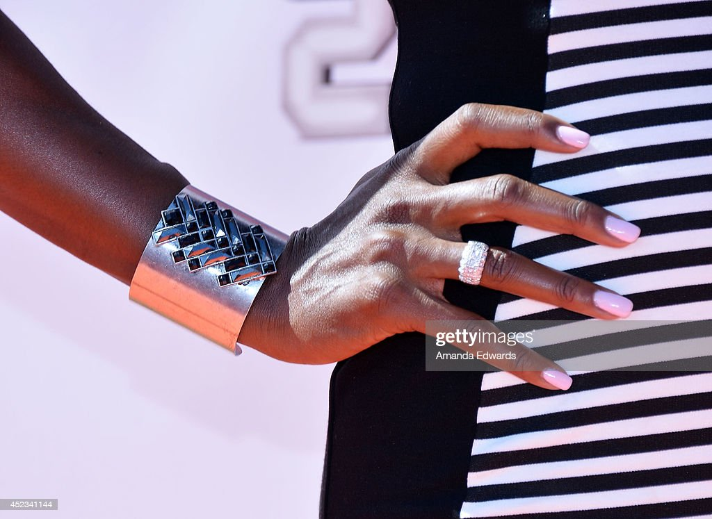 Former WNBA player Lisa Leslie (jewelry detail) arrives at the Nickelodeon Kids' Choice Sports Awards 2014 on July 17, 2014 in Los Angeles, California.