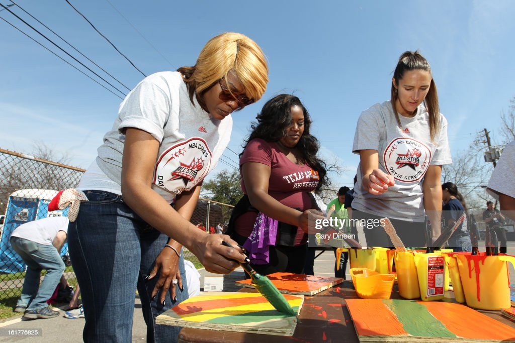 Former WNBA player Sheryl Swoopes helps current WNBA player Ruth Riley of the Chicago Sky and Sheila Jackson Lee paint at the 2013 NBA Cares Day of Service at the Playground Build with KaBOOM! on February 15, 2013 in Houston, Texas.