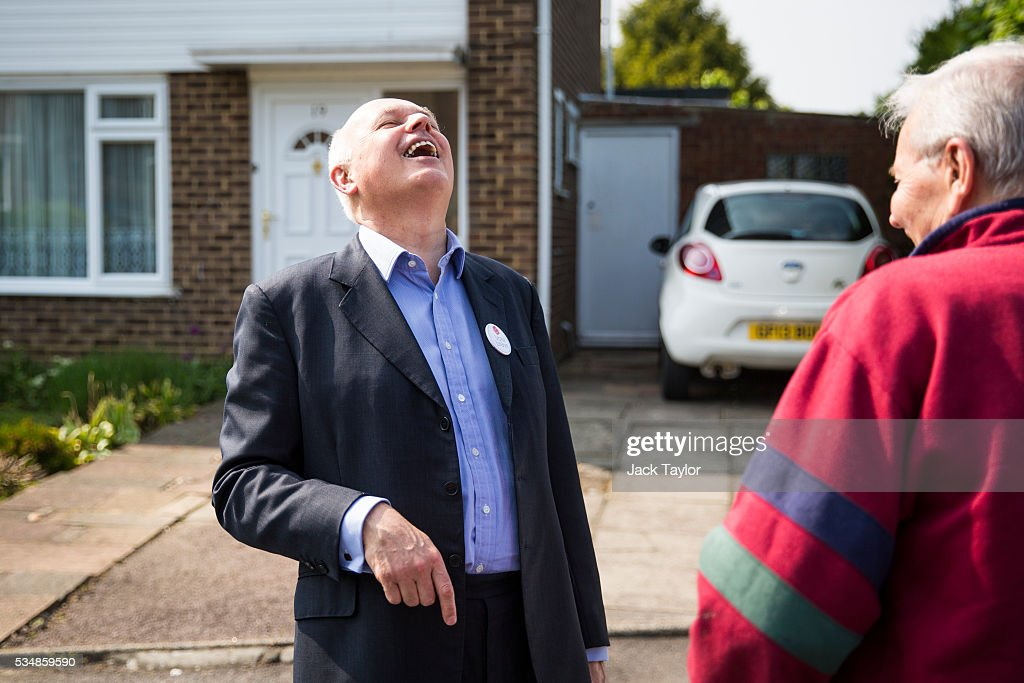 Former Work and Pensions Secretary <a gi-track='captionPersonalityLinkClicked' href=/galleries/search?phrase=Iain+Duncan+Smith&family=editorial&specificpeople=159312 ng-click='$event.stopPropagation()'>Iain Duncan Smith</a> laughs with a local resident while out canvassing on behalf of Vote Leave on May 28, 2016 in Maidstone, England. Former Work and Pensions Secretary <a gi-track='captionPersonalityLinkClicked' href=/galleries/search?phrase=Iain+Duncan+Smith&family=editorial&specificpeople=159312 ng-click='$event.stopPropagation()'>Iain Duncan Smith</a> and Employment Secretary Priti Patel are in Kent today campaigning for a vote to leave the European Union, ahead of the EU referendum on June 23rd.