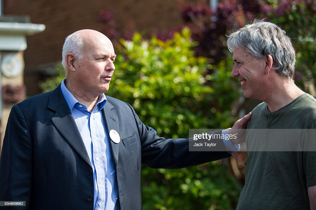 Former Work and Pensions Secretary <a gi-track='captionPersonalityLinkClicked' href=/galleries/search?phrase=Iain+Duncan+Smith&family=editorial&specificpeople=159312 ng-click='$event.stopPropagation()'>Iain Duncan Smith</a> (L) speaks with a local resident while out canvassing on behalf of Vote Leave on May 28, 2016 in Maidstone, England. Former Work and Pensions Secretary <a gi-track='captionPersonalityLinkClicked' href=/galleries/search?phrase=Iain+Duncan+Smith&family=editorial&specificpeople=159312 ng-click='$event.stopPropagation()'>Iain Duncan Smith</a> and Employment Secretary Priti Patel are in Kent today campaigning for a vote to leave the European Union, ahead of the EU referendum on June 23rd.