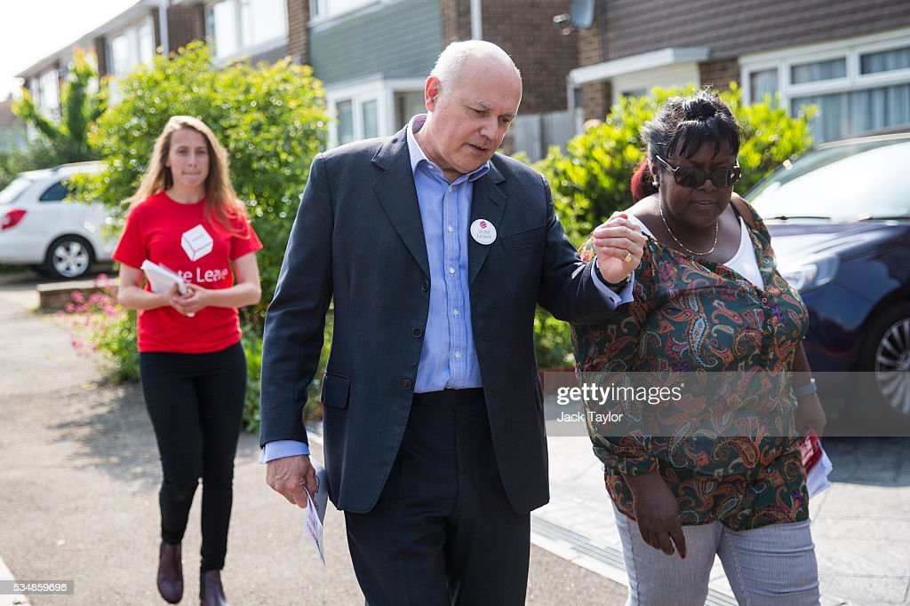 Former Work and Pensions Secretary <a gi-track='captionPersonalityLinkClicked' href=/galleries/search?phrase=Iain+Duncan+Smith&family=editorial&specificpeople=159312 ng-click='$event.stopPropagation()'>Iain Duncan Smith</a> (C) speaks with a local campaigner while out canvassing on behalf of Vote Leave on May 28, 2016 in Maidstone, England. Former Work and Pensions Secretary <a gi-track='captionPersonalityLinkClicked' href=/galleries/search?phrase=Iain+Duncan+Smith&family=editorial&specificpeople=159312 ng-click='$event.stopPropagation()'>Iain Duncan Smith</a> and Employment Secretary Priti Patel are in Kent today campaigning for a vote to leave the European Union, ahead of the EU referendum on June 23rd.