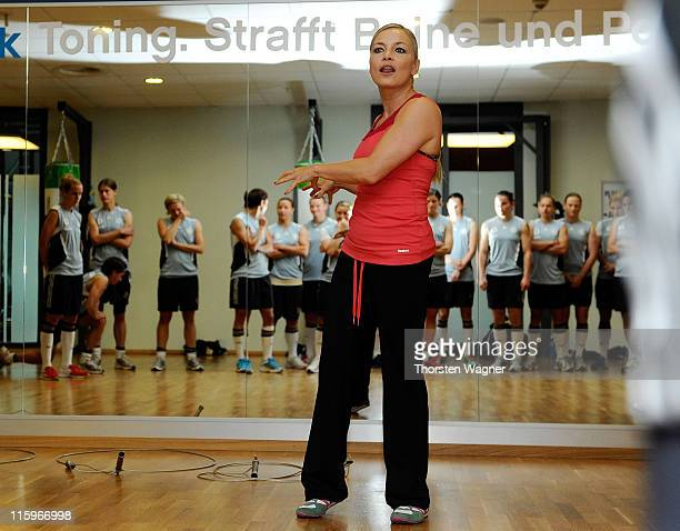 Former world boxing champion Regina Halmich gives instructions during a Germany training session at Fitness First club on June 13 2011 in Frankfurt...
