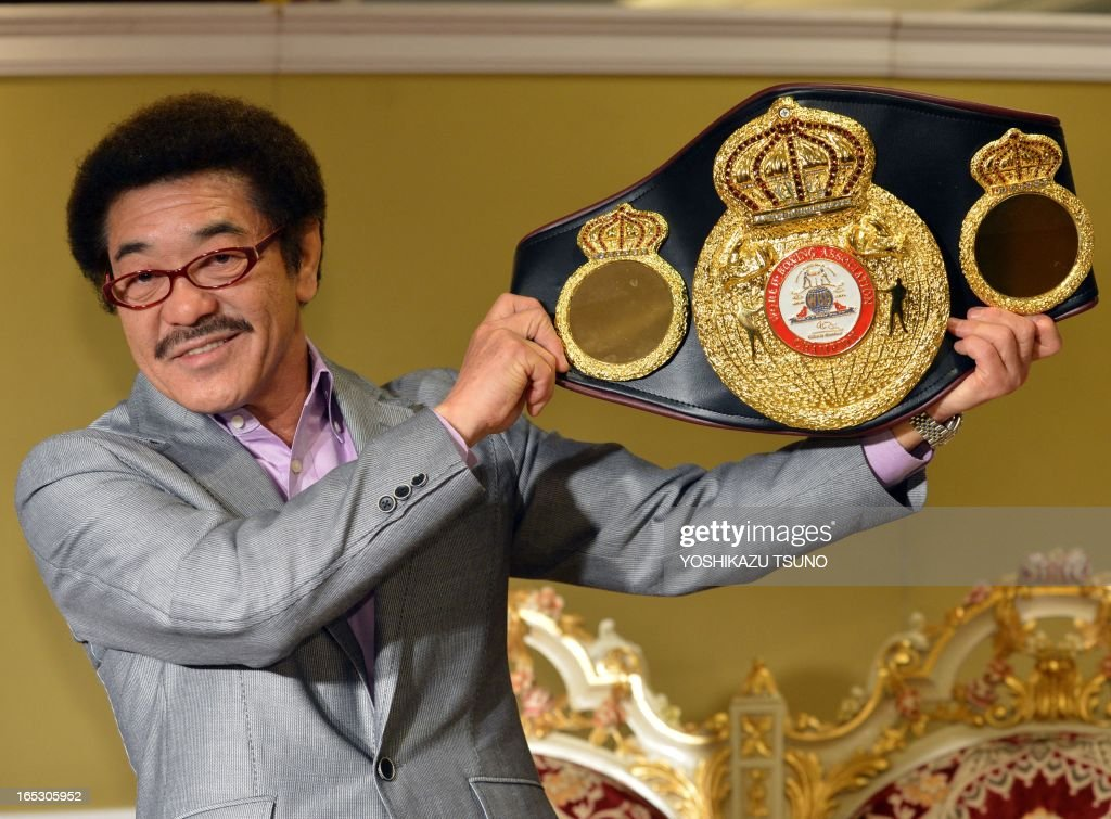 Former world boxing champion Yoko Gushiken, who detained his champion belt 13 times, displays his gold made champion's belt at the opening event of the 'Gold Expo' exhibition at Tokyo's Matsuzakaya department store on April 3, 2013. The exhibition will display and sell a total of 12 billion yen (130 million USD) gold made products, including a 120kg gold bar priced at 600 million yen (6.5 million USD). AFP PHOTO / Yoshikazu TSUNO