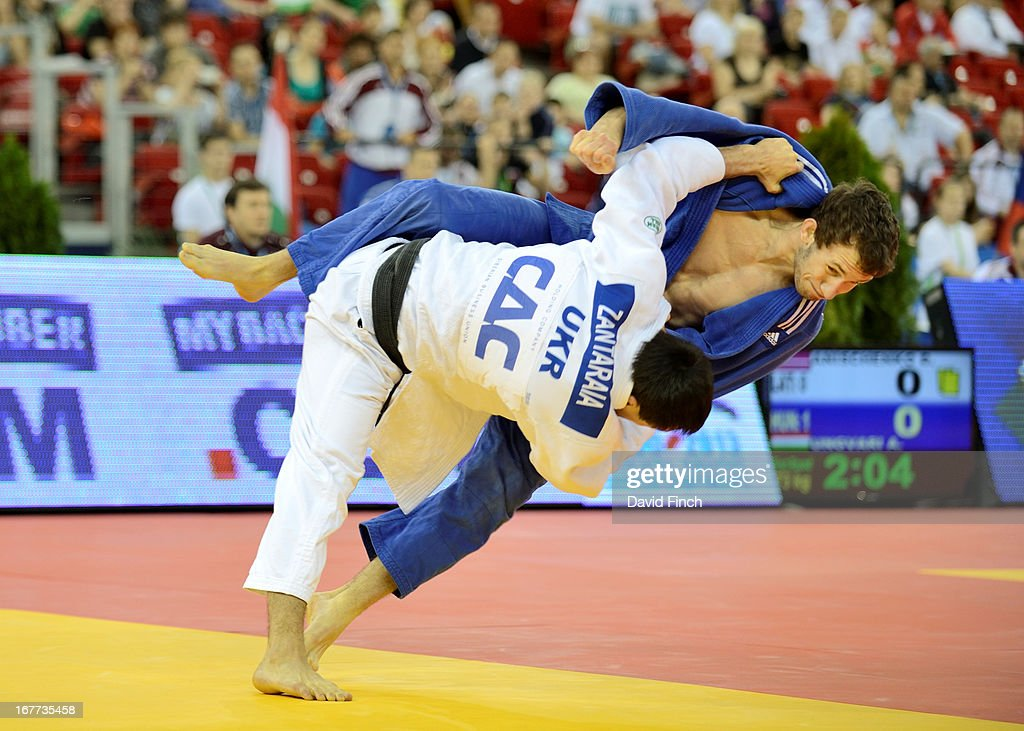 Former World champion, Georgiy Zantaraia of the Ukraine team (white), throws Georg Reiter of Austria for ippon at the Budapest European Team Championships held at the Papp Laszlo Sports Hall, Budapest, Hungary, on April 28, 2013.