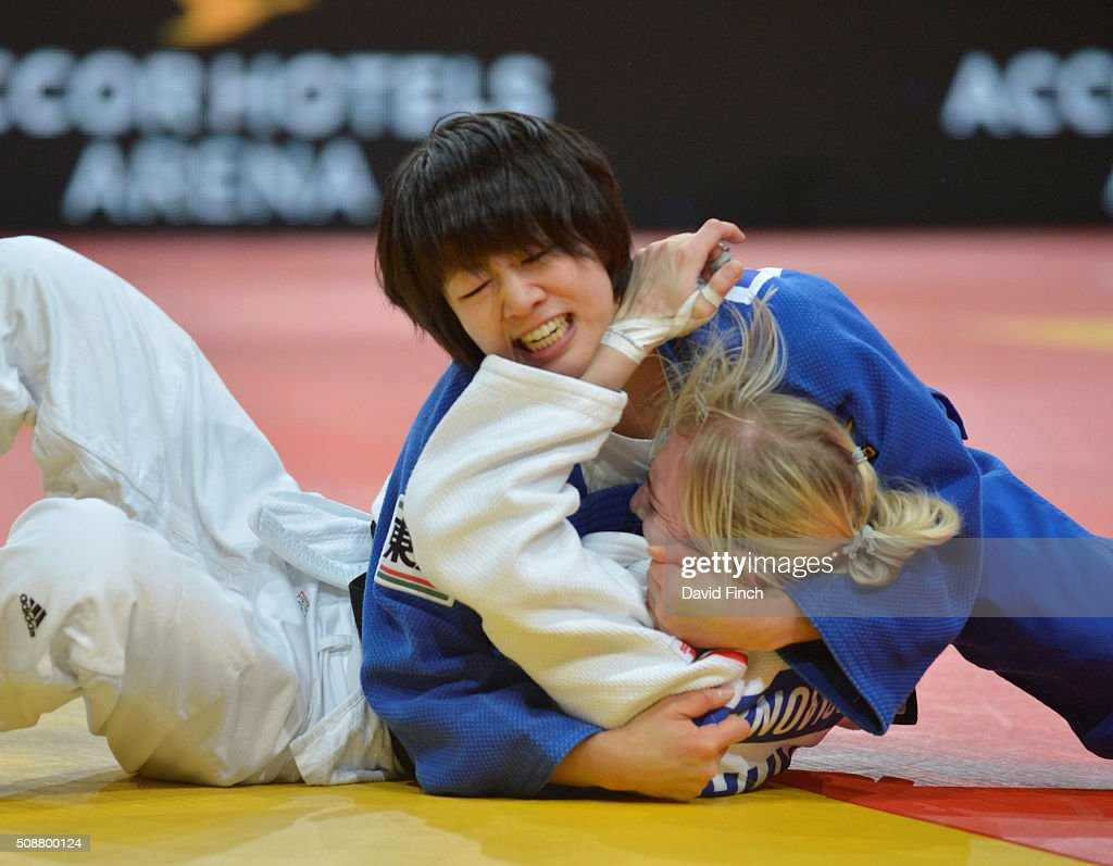 Former world champion Haruna Asami of Japan holds Eva Csernoviczki of Hungary for an ippon to reach the u48kg semifinal during the 2016 Paris Judo...