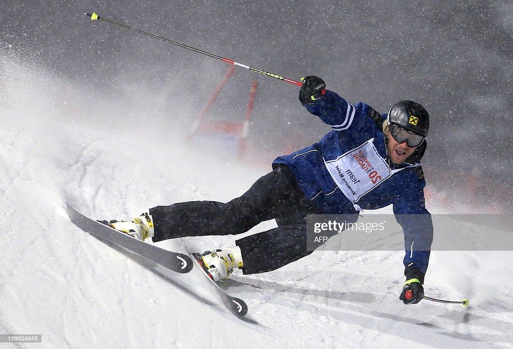 Former world champion, Olympic gold medalist, Austria's ski legend Hermann Maier skis during a ski exhibition night race in Flachau on January 14, 2013.