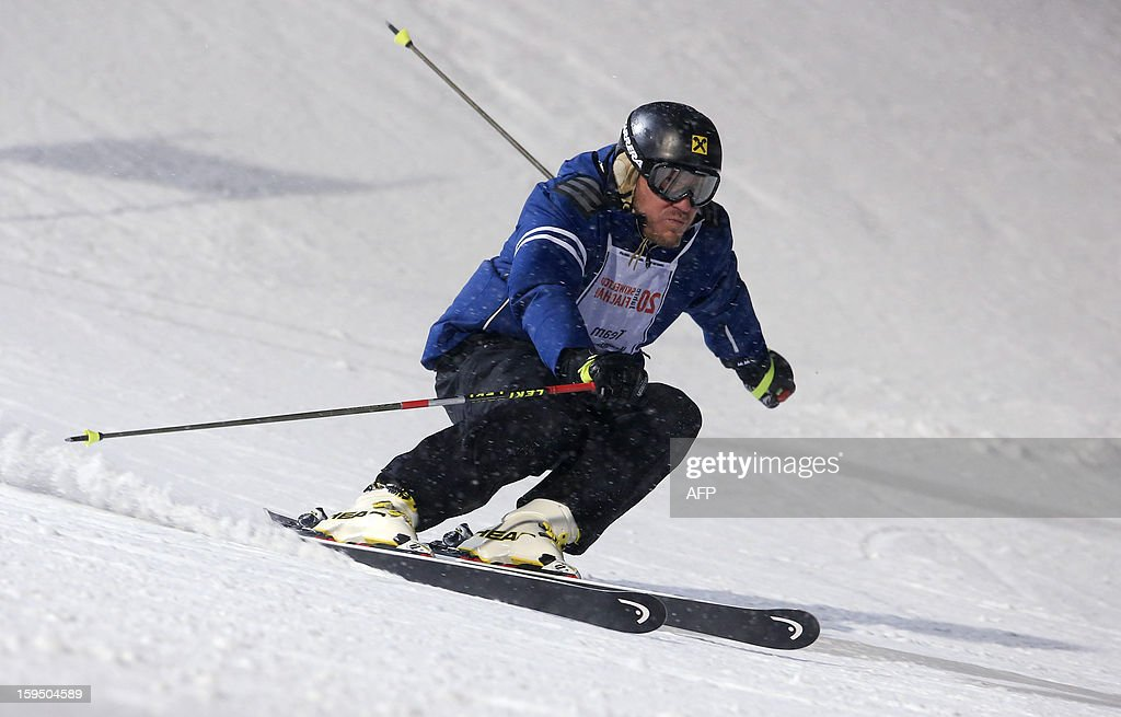 Former world champion, Olympic gold medalist, Austria's ski legend Hermann Maier skis during a ski exhibition night race in Flachau on January 14, 2013.