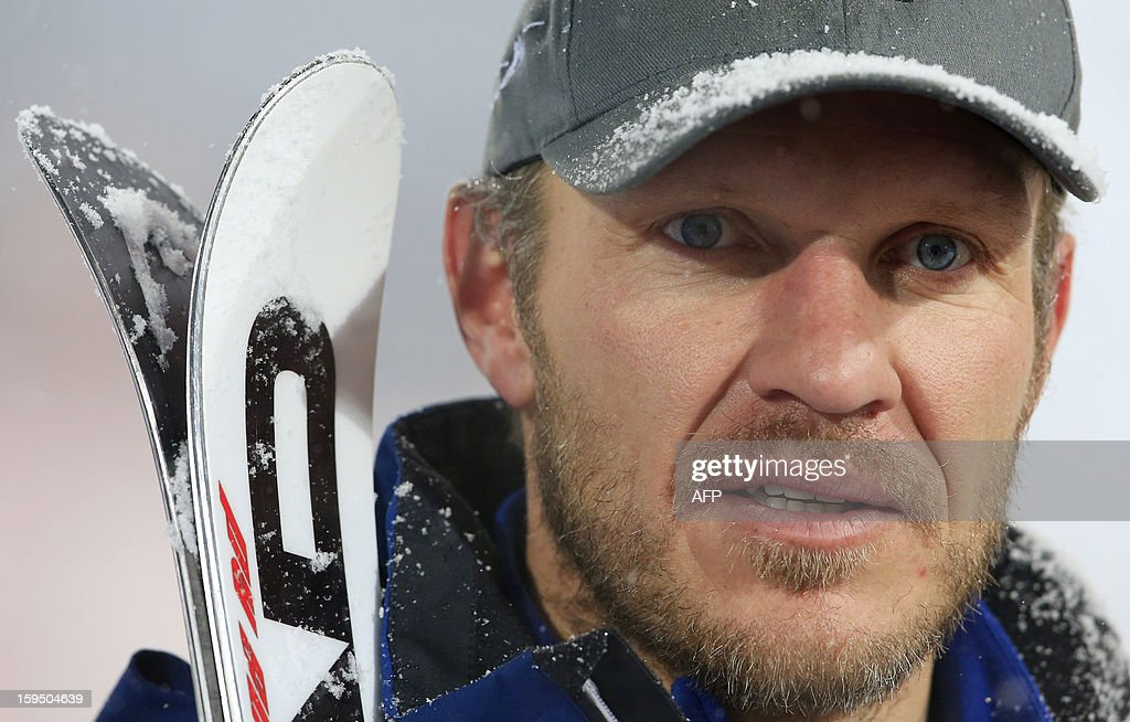 Former world champion, Olympic gold medalist, Austria's ski legend Hermann Maier looks on after a ski exhibition night race in Flachau on January 14, 2013.