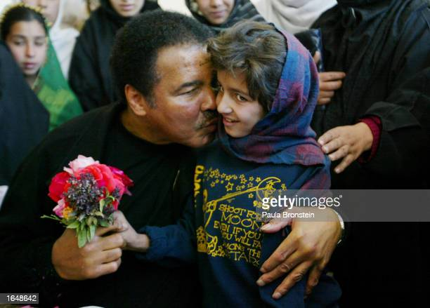 Former world heavyweight boxing champion Muhammad Ali gives a kiss to a Afghan students during his visit to Karte Sei High school for Girls...