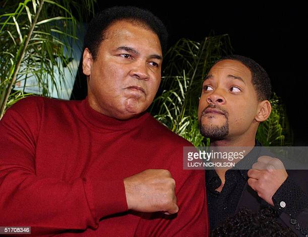US former world heavyweight boxing champion Muhammad Ali jokes with US actor Will Smith who portrays him in new film 'Ali' at the movie's premiere in...