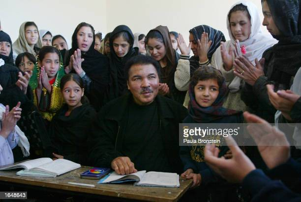 Former world heavyweight boxing champion Muhammad Ali sits with Afghan students during his visit to Karte Sei High school for Girls November18 2002...