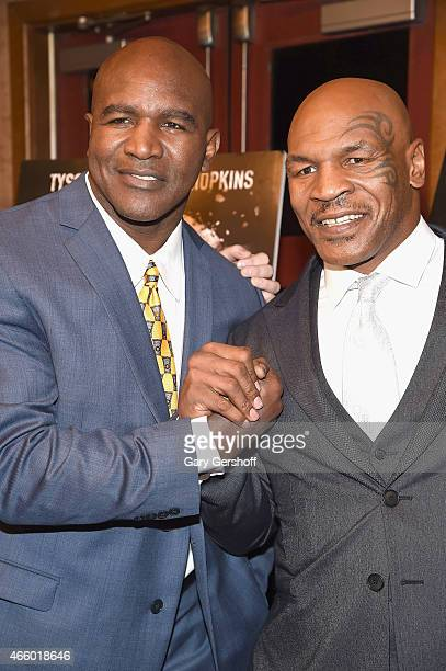 Former world heavyweight boxing champions Evander Holyfield and Mike Tyson attend the 'Champs' New York Screening at Village East Cinema on March 12...
