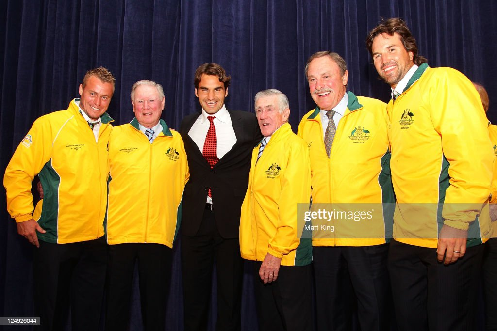 Former world number one tennis players (L-R) <a gi-track='captionPersonalityLinkClicked' href=/galleries/search?phrase=Lleyton+Hewitt&family=editorial&specificpeople=167178 ng-click='$event.stopPropagation()'>Lleyton Hewitt</a>, <a gi-track='captionPersonalityLinkClicked' href=/galleries/search?phrase=Frank+Sedgman&family=editorial&specificpeople=221315 ng-click='$event.stopPropagation()'>Frank Sedgman</a>, <a gi-track='captionPersonalityLinkClicked' href=/galleries/search?phrase=Roger+Federer&family=editorial&specificpeople=157480 ng-click='$event.stopPropagation()'>Roger Federer</a>, <a gi-track='captionPersonalityLinkClicked' href=/galleries/search?phrase=Ken+Rosewall&family=editorial&specificpeople=208136 ng-click='$event.stopPropagation()'>Ken Rosewall</a>, <a gi-track='captionPersonalityLinkClicked' href=/galleries/search?phrase=John+Newcombe&family=editorial&specificpeople=221457 ng-click='$event.stopPropagation()'>John Newcombe</a> and Pat Rafter appear on stage during the official dinner ahead of the Davis Cup World Group Playoff Tie between Australia and Switzerland at The Westin on September 14, 2011 in Sydney, Australia.