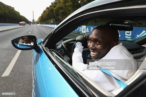 Former world record holder Wilson Kipsang of Kenya top favorites of the 43 BMW Berlin Marathon 2016 drives a BMW i8 at the Siegessaeule on September...