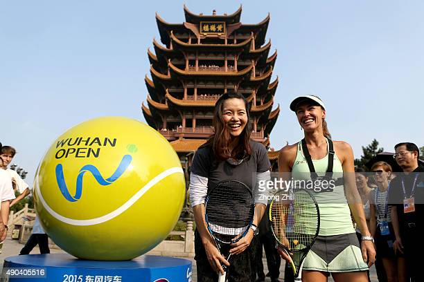 Former WTA player Li Na of China with Martina Hingis of Switzerland during the Yellow Crane Tower event on Day 2 of 2015 Dongfeng Motor Wuhan Open on...