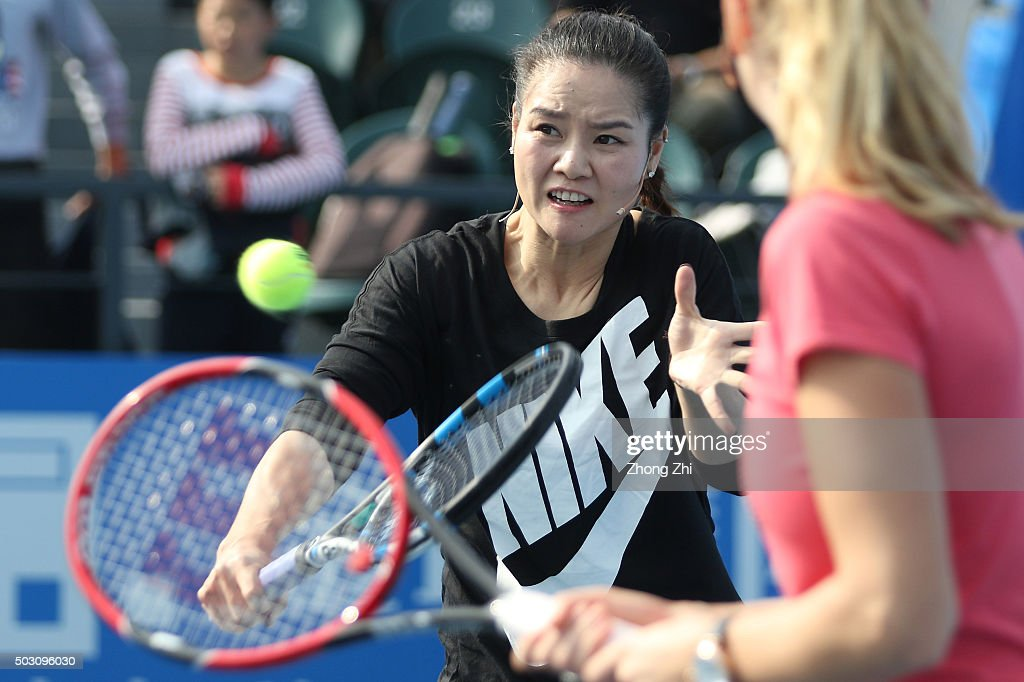 Former WTA player Li Na returns a shot with Petra Kvitova of Czech Republic during the Li Na Kids Day as a part of event of the 2016 WTA Shenzhen Open at Longgang Sports Center on January 1, 2016 in Shenzhen, China.