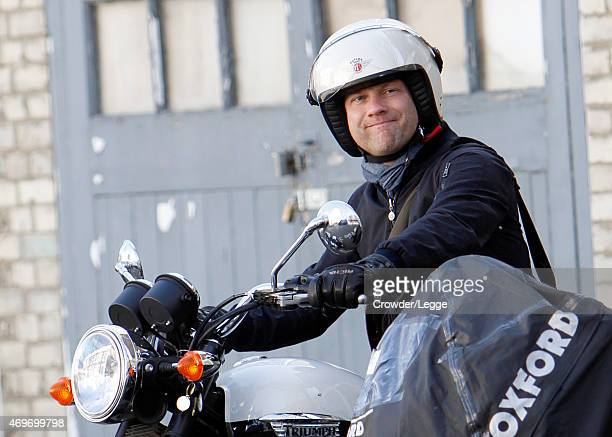 Former X factor Presenter Dermot O'Leary pictured taking a ride on his Triumph Motorcycle in Sunny London on April 14 2015 in London England