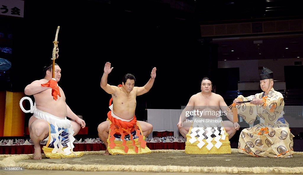 Former yokozuna sumo grand champion Chiyonofuji now stablemaster Kokonoe performs the the 'Dohyoiri' ring purification ritual along with Mongolian...