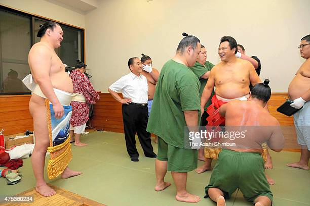 Former yokozuna sumo grand champion Chiyonofuji stablemaster Kokonoe speaks to Mongolian yokozuna Hakuho during preparation for performing the...