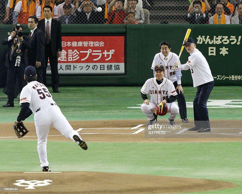 Former Yomiuri Giants and New York Yankees slugger Hideki Matsui pitches to Japanese legendary slugger Shigeo Nagashima with current Yomiuri Giants...