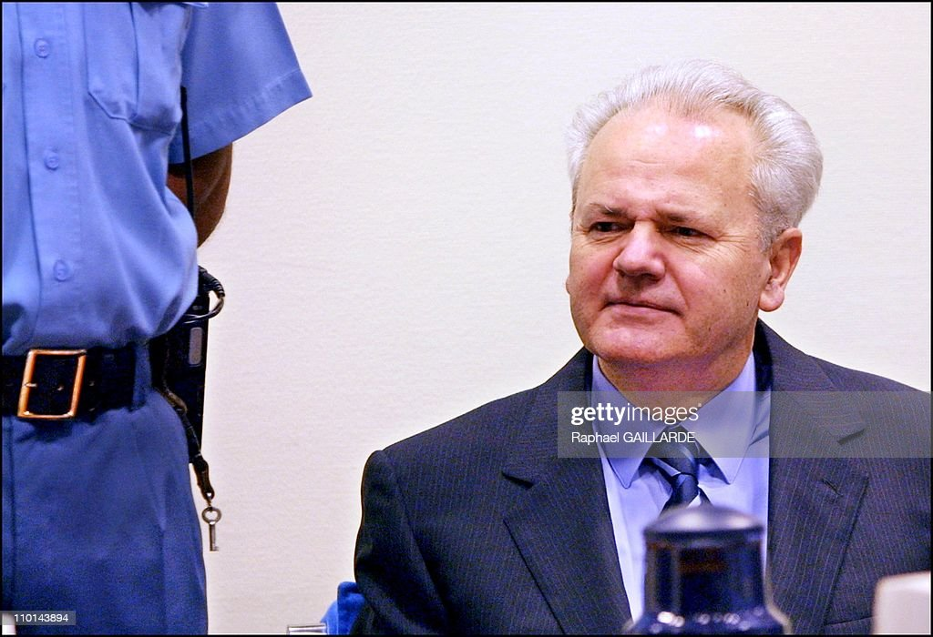 Former Yugoslav President <a gi-track='captionPersonalityLinkClicked' href=/galleries/search?phrase=Slobodan+Milosevic&family=editorial&specificpeople=206908 ng-click='$event.stopPropagation()'>Slobodan Milosevic</a> appears at the war crimes tribunal in The Hague, Netherlands on February 12, 2002 - According to Chief Prosecutor Carla Del Ponte, Milosevic oversaw the murder of over 1,000 people and the displacement of more than 1 million people in the former Yugoslavia - The trial marks the first time that a head of state appeared for a United Nations Tribunal.