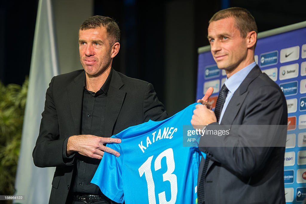 Former Yugoslavian international Srecko Katanec (L) poses with Aleksander Ceferin, President of Slovenia's Football Association, during a press conference as he officially become today Slovenian national football team's coach for the second time on January 4, 2013 in Brdo. Katanec previously coached Slovenia between 1998 and 2002, taking the former Yugoslav republic to the final stages of the 2000 European Championship and the 2002 World Cup. AFP PHOTO / JURE MAKOVEC