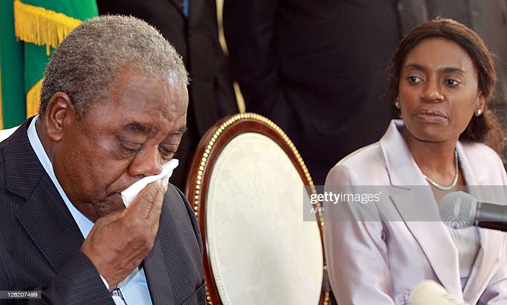 Former Zambian President Rupiah Banda reacts after accepting his defeat against Michael Sata in the general elections as his wife Thandiwe looks on...