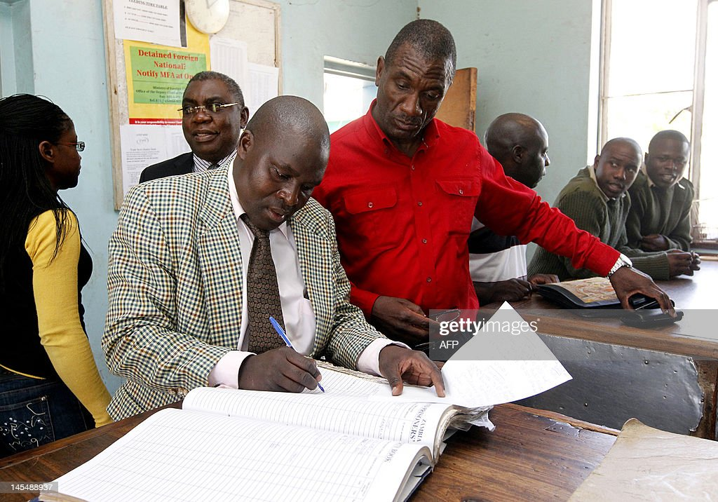 Former Zambian President Rupiah Banda's son Andrew prepares to leave Woodlands Police Station with his lawyer Sakwiba Sikota on May 31 2012 in Lusaka...