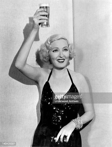 Former Ziegfeld showgirl and sometimes actress Peggy Hopkins Joyce raises a glass of beer to celebrate the end of Prohibition Hollywood California...