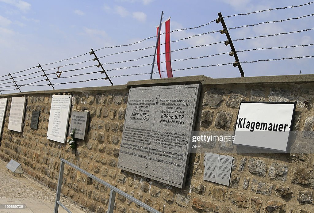 Formerly electrified barbed wires are seen on the walls of the World War II concentration camp of Mauthausen, on April 17, 2013.