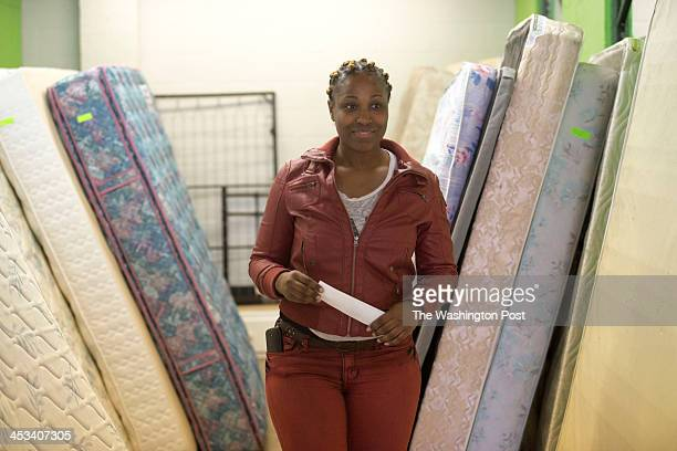 19 Formerly homeless Flavia Ford receives a mattress and free furniture from the nonprofit A Wider Circle in Silver Spring Maryland on November 19...