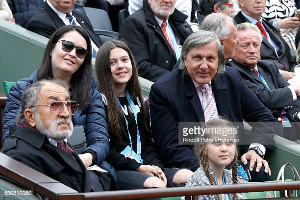 Formers Tennis players Ilie Nastase Ion Tiriac and Ilie's family attend Day Eleven of the 2016 French Tennis Open at Roland Garros on June 1 2016 in...