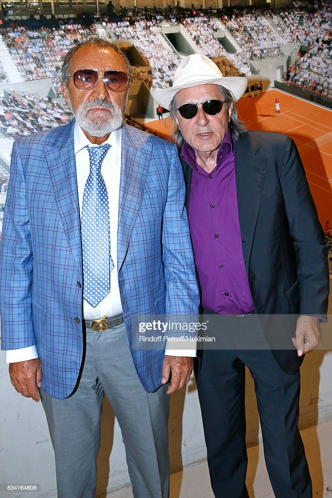 Formers Tennis players Ion Tiriac and <a gi-track='captionPersonalityLinkClicked' href=/galleries/search?phrase=Ilie+Nastase&family=editorial&specificpeople=215468 ng-click='$event.stopPropagation()'>Ilie Nastase</a> attend the 2016 French Tennis Open - Day Four at Roland Garros on May 25, 2016 in Paris, France.