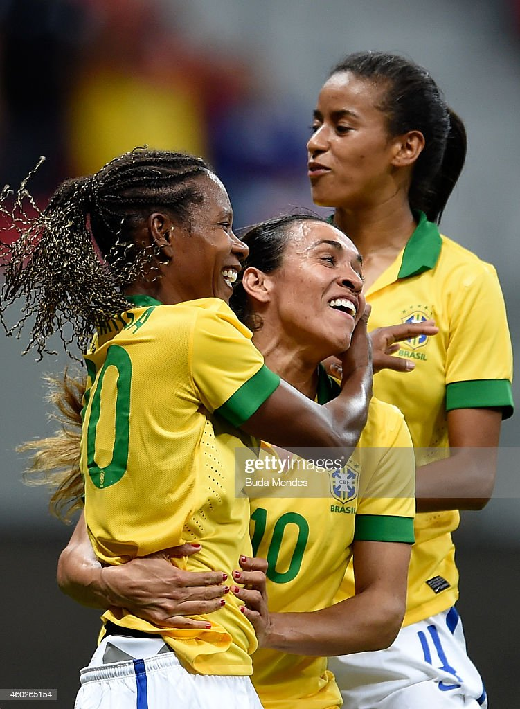 Formiga (L) and <a gi-track='captionPersonalityLinkClicked' href=/galleries/search?phrase=Marta+-+Soccer+Player&family=editorial&specificpeople=3038337 ng-click='$event.stopPropagation()'>Marta</a> (C) of Brazil celebrate a scored goal against Argentina during a match between Brazil and Argentina as part of International Women's Football Tournament of Brasilia at Mane Garrincha Stadium on December 10, 2014 in Brasilia, Brazil.